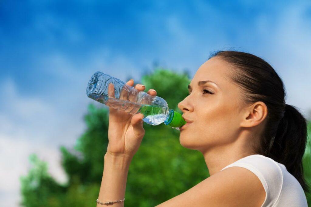 woman drinking a bottle of water